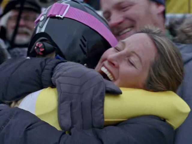 Mom and her athlete share a celebratory hug (businessinsider.com).
